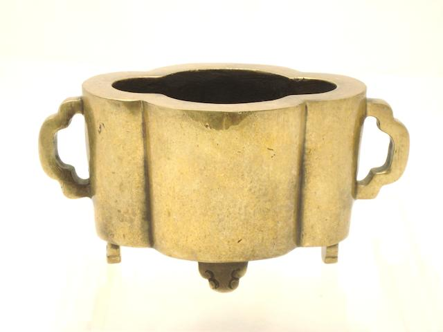 A quatrefoil bronze censer Bearing Xuande two character mark but 19th century