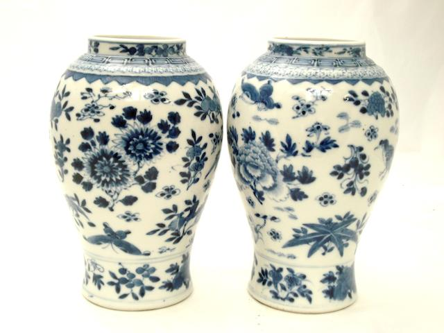 A pair of blue and white vases Bearing four character Kangxi marks but late 19th century
