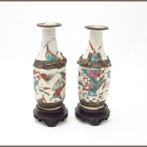 A pair of small famille rose crackle glazed vases Circa 1900