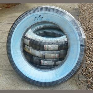 A set of five Firestone white-wall tyres,
