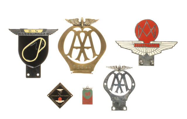 Four motoring badges,