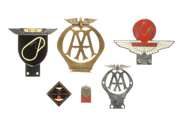 Four motoring badges,