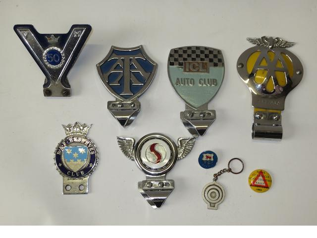Six car badges,