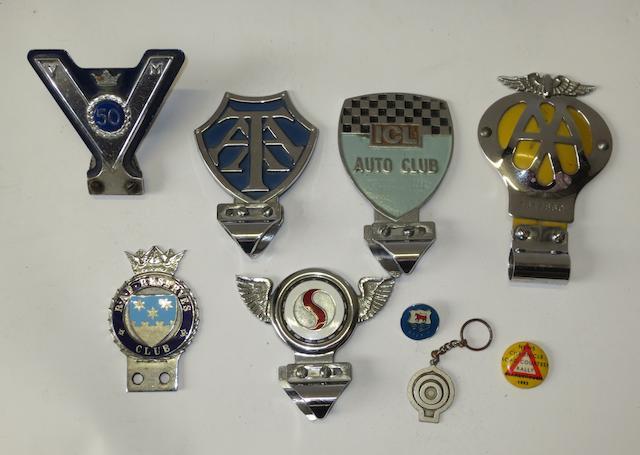 Six car badges,