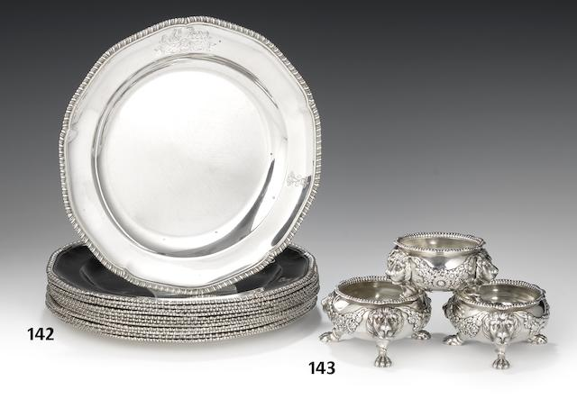 A suite of three George III silver salt cellars by William Burwash & Richard Sibley, London 1811  together with three salt spoons (6)