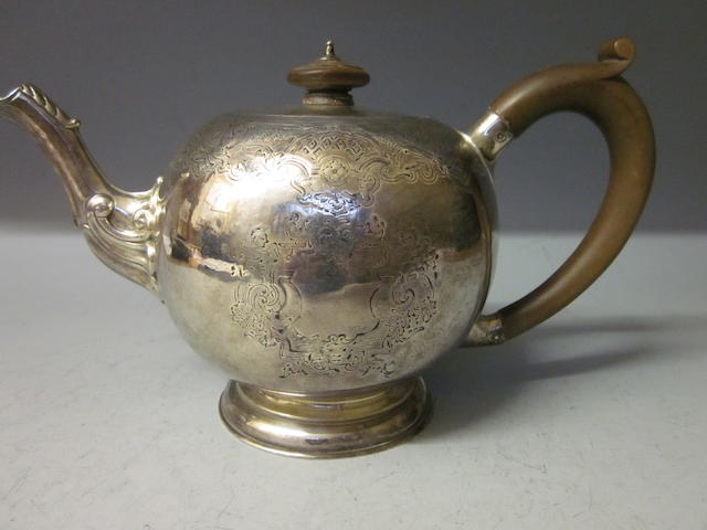 A Victorian silver bullet shaped Teapot, by George Lambert London 1895,