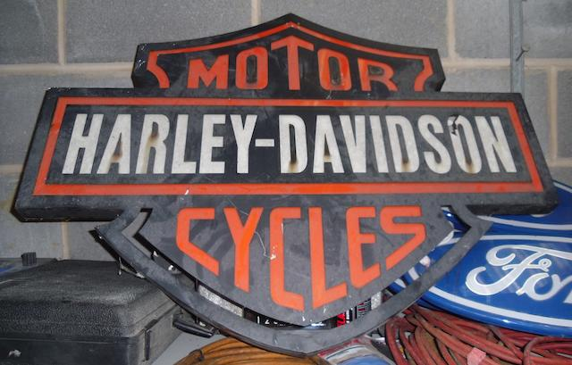 A Harley-Davidson Motor Cycles showroom sign,