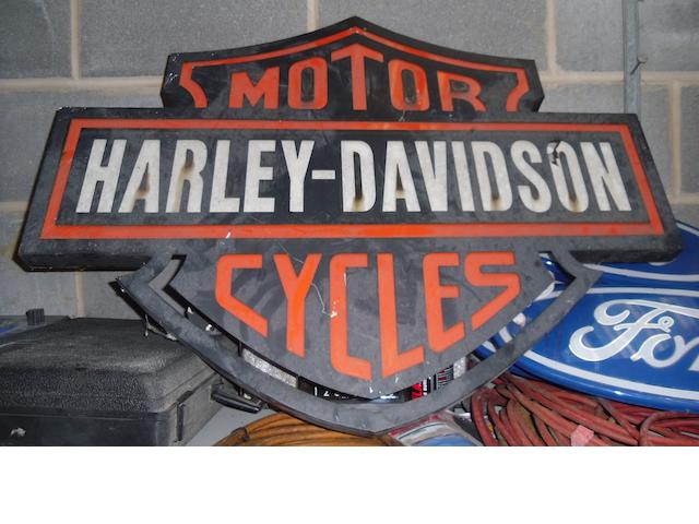 A Harley-Davidson Motor Cycles showroom sign,