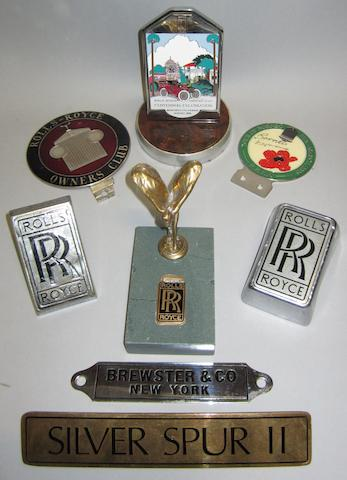 Three Rolls-Royce badges,