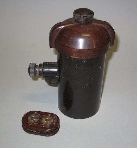 A Rolls-Royce Bakelite ignititon coil, pre-War,