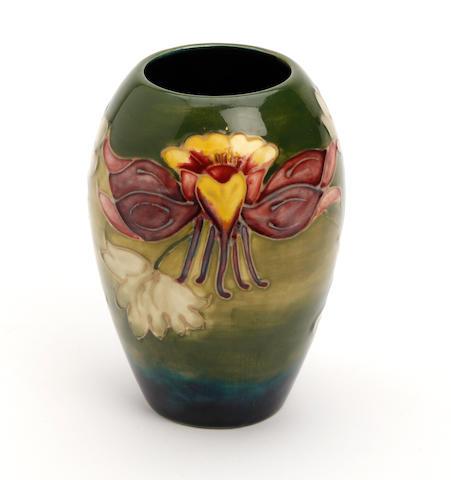 A Walter Moorcroft 'Columbine' pattern vase  Circa 1950