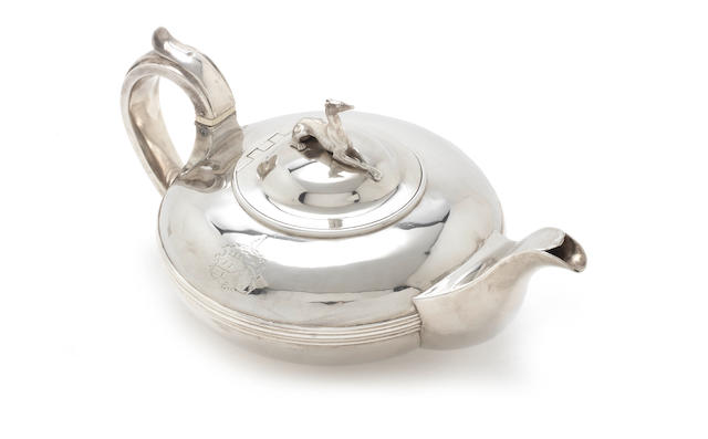 A compressed circualr teapot  with grey hound finial