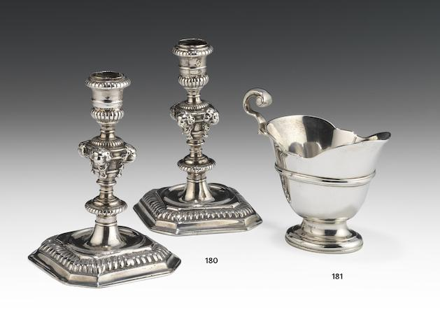 A pair of William and Mary cast silver candlesticks by Francis Nelme, London 1695  (2)