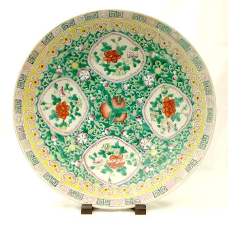 A large famille rose circular saucer dish Circa 1900