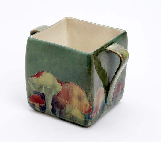 A William Moorcroft 'Claremont' design biscuit barrel, lacking cover  Circa 1914