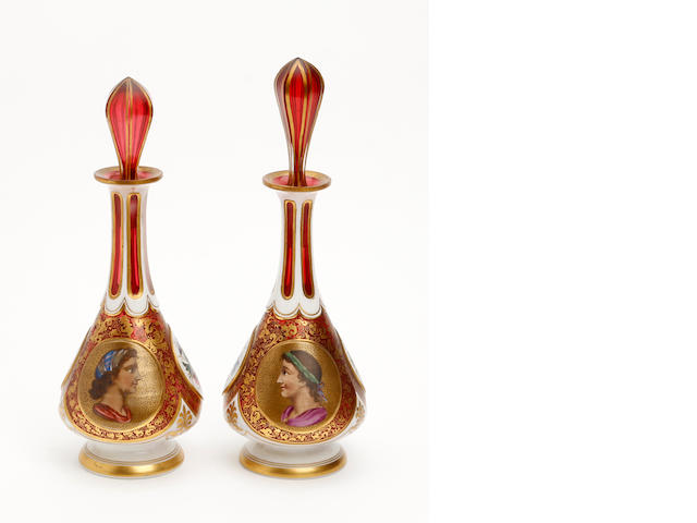 Two bohemian ruby flash and overlay glass vases and matched stoppers  Circa 1900