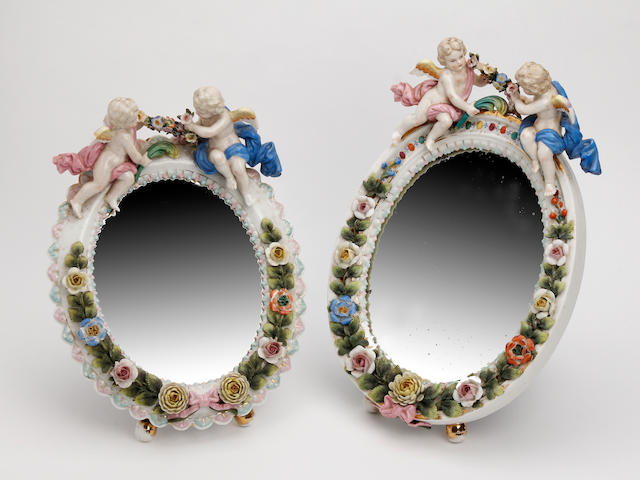 Two Meissen style standing table mirrors  Late 19th Century