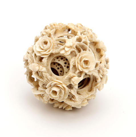 A Chinese carved ivory puzzle ball  Circa 1890-1910