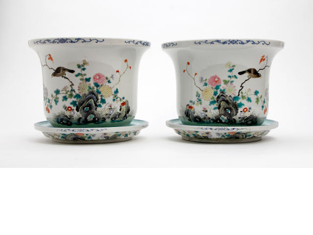 A pair of Chinese famille rose jardinieres and stands 20th Century