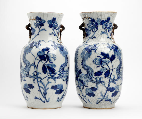 A Composite garniture of crackle glazed blue and white vases Circa 1900