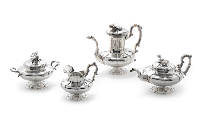 A 19th century Belgian silver tea and coffee service maker's mark 'JVM?' in italics in a lozenge punch, 800 standard, 1831-1868  (4)