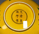 A pair of Chinese green and yellow glazed saucer dishes, a smaller pair and a larger saucer dish, Yongzheng six-character marks but later