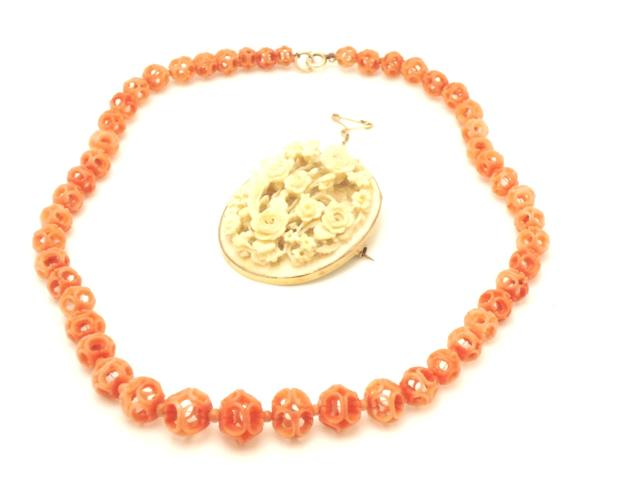 A coral necklace and ivory brooch 19th Century