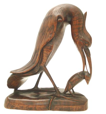 An inlaid and carved wood stork and rat group Circa 1900