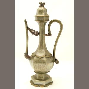 A tall pewter ewer and cover Circa 1900