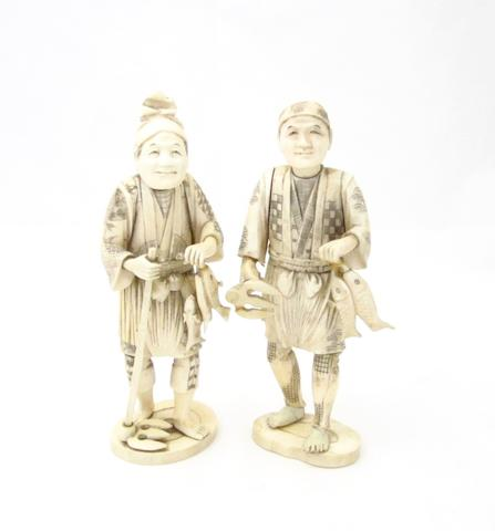 A pair of sectional marine ivory figures Meiji