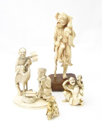 A collection of four ivory figure groups Meiji