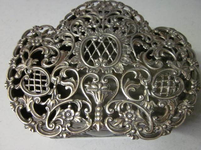 A silver pot pourri box  by Samuel Jacob London 1902,