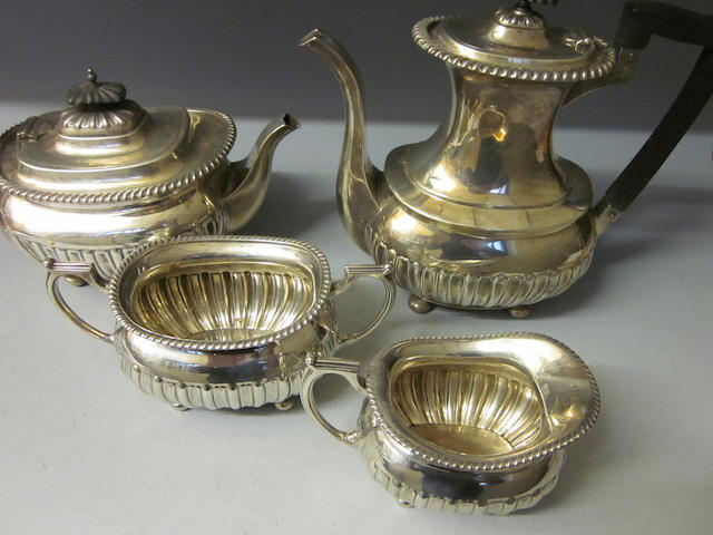 A four piece silver tea and coffee service,  by Walker and Hall, Sheffield 1913,   (4)