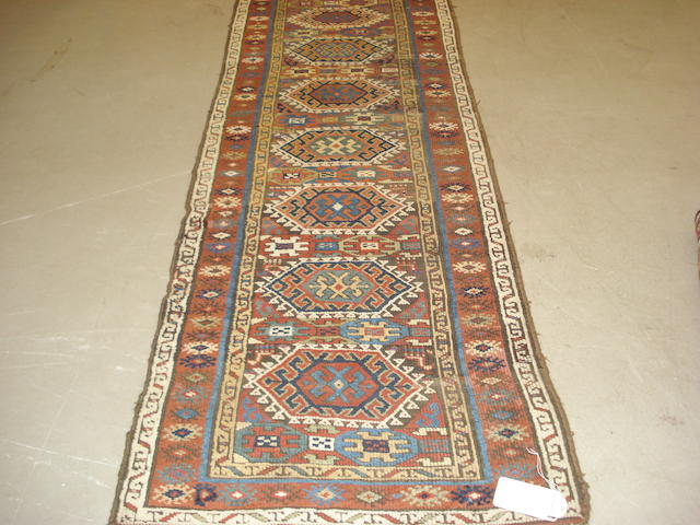 A North West Persian runner, 400cm x 97cm