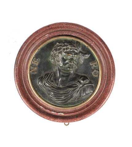 A German late 16th / early 17th century  patinated and gilt bronze roundel portrait of the Emperor Nero