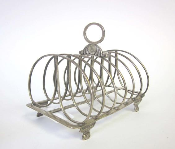 A William IV  silver  toast rack  by Thomas Wheatly, Newcastle 1832, together with a quantity of other items (6)