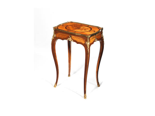 A French Louis XV ormolu-mounted amaranth, kingwood and tulipwood parquetry and marquetry occasional tablein the manner of BVRB