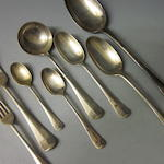 A silver composite canteen of rat-tail pattern flatware,  by William Hutton and Sons Ltd,  London 1905, 1906, 1907,   (Qty)
