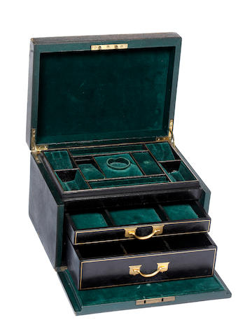 A large gold tooled green leather jewellery box containing assorted antique jewellery