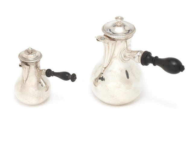 An early 19th century Parisian silver coffee pot with matched egoiste pot coffee pot by Gabriel-Jaques-Andre Bompart, egoist pot with standard mark only, both Paris 1819-38  (2)