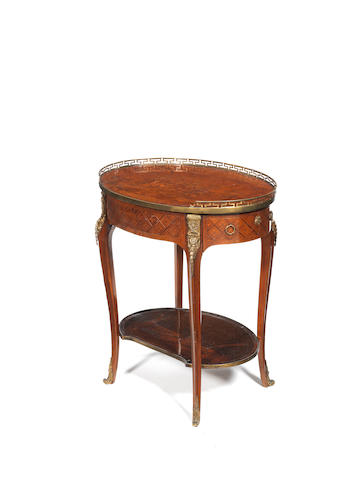 A French late 19th century gilt-metal mounted and mother of pearl inlaid sycamore, marquetry and parquetry oval gueridon in the manner of Topino