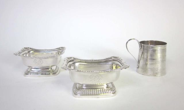 A pair of matched George III silver salts maker's mark W.E?,  London 1809 and 1815, together with a pair of graduating swing-handled sugar baskets and a small presentation tankard  (5)