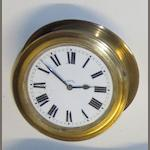 A brass 8-day car clock for dashboard mounting,