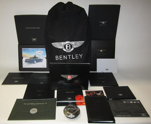 Assorted Bentley publications and a Bentley Continental car cover,