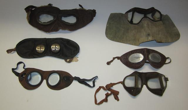 Six pairs of early motoring goggles,