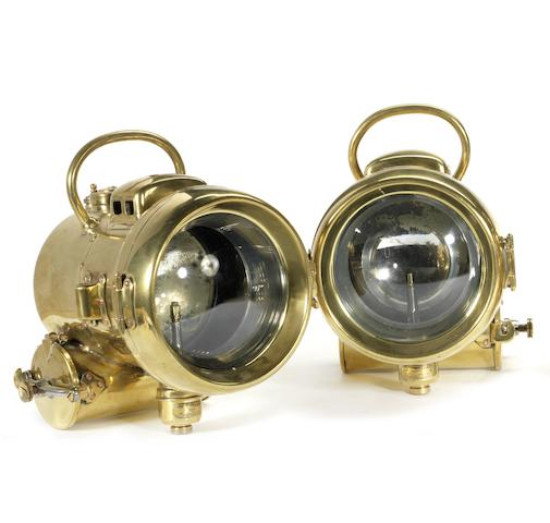A pair of Powell and Hanmer, model B330, self-generating acetylene headlamps, British,