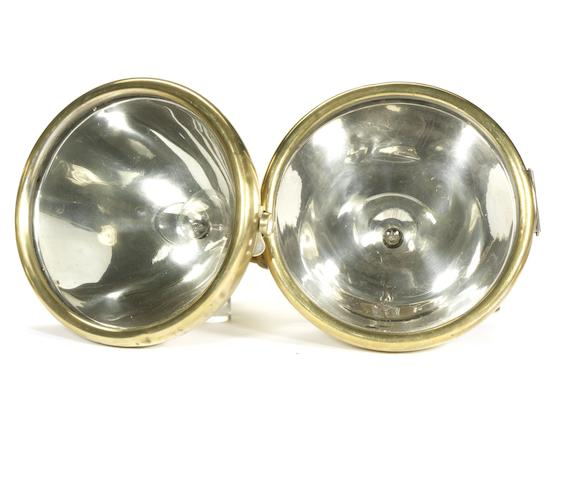 A pair of Bleriot electric headlamps, French,