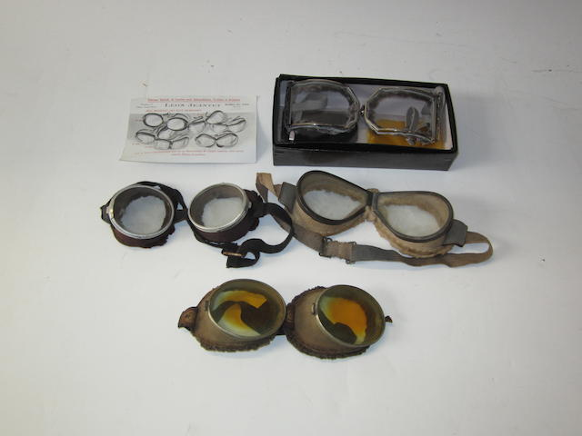 Four pairs of motoring goggles,