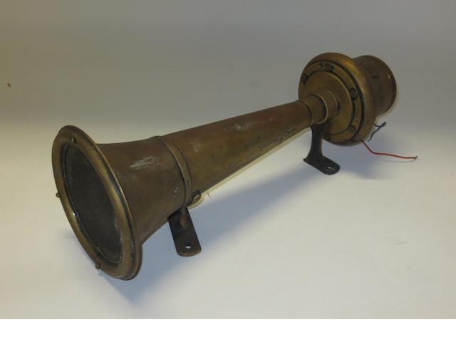 An Edwardian CAV brass electric trumpet horn,