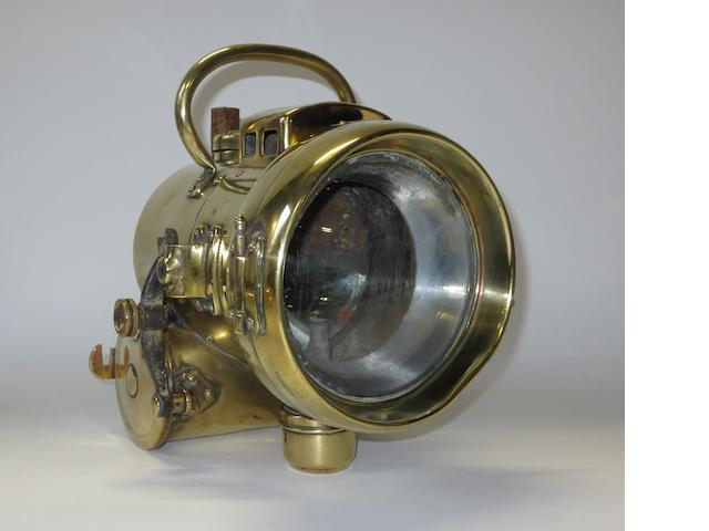 A Powell & Hanmer self-generating acetylene headlamp,
